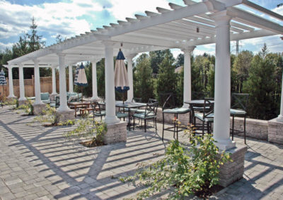 White gazebo and black chairs on patio